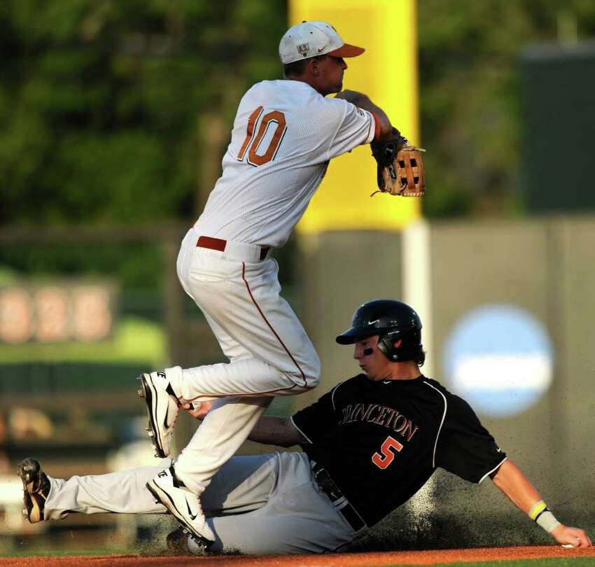 Princeton runner Alex Flink slides safely into second base as as Texas shortstop Brandon Loy throws to first during the NCAA Baseball Austin Regional on Friday, June 3, 2011. BILLY CALZADA / gcalzada@express-news.net