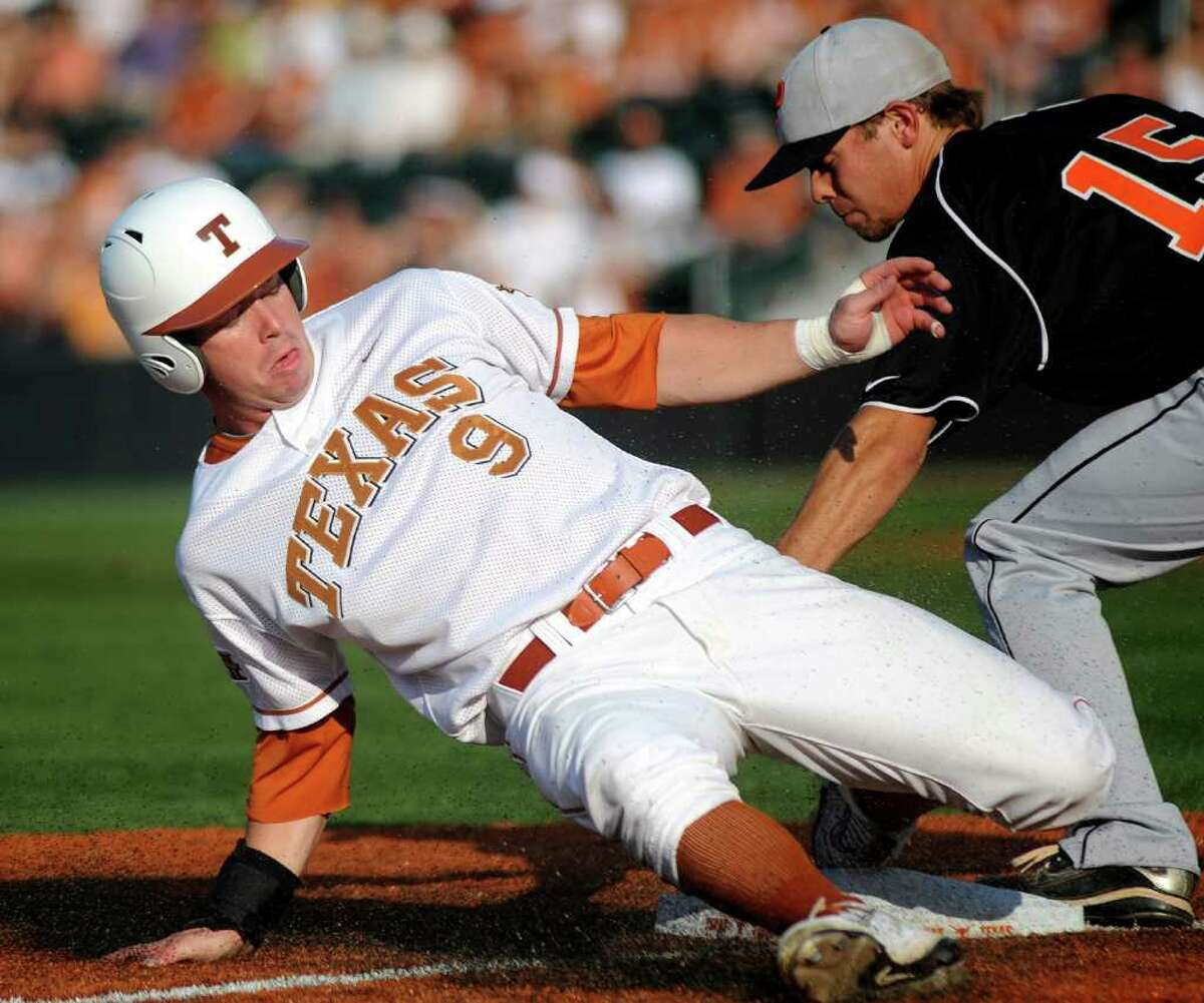 Texas runner Tant Shepherd steals third base as Jonathan York of Princeton applies a late tag during the first inning of NCAA Baseball Austin Regional on Friday, June 3, 2011. BILLY CALZADA / gcalzada@express-news.net