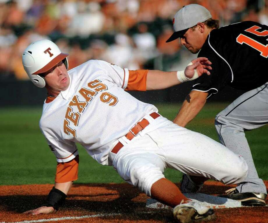 Texas runner Tant Shepherd steals third base as Jonathan York of Princeton applies a late tag during the first inning of NCAA Baseball Austin Regional on Friday, June 3, 2011. BILLY CALZADA / gcalzada@express-news.net Photo: BILLY CALZADA, Express-News / gcalzada@express-news.net