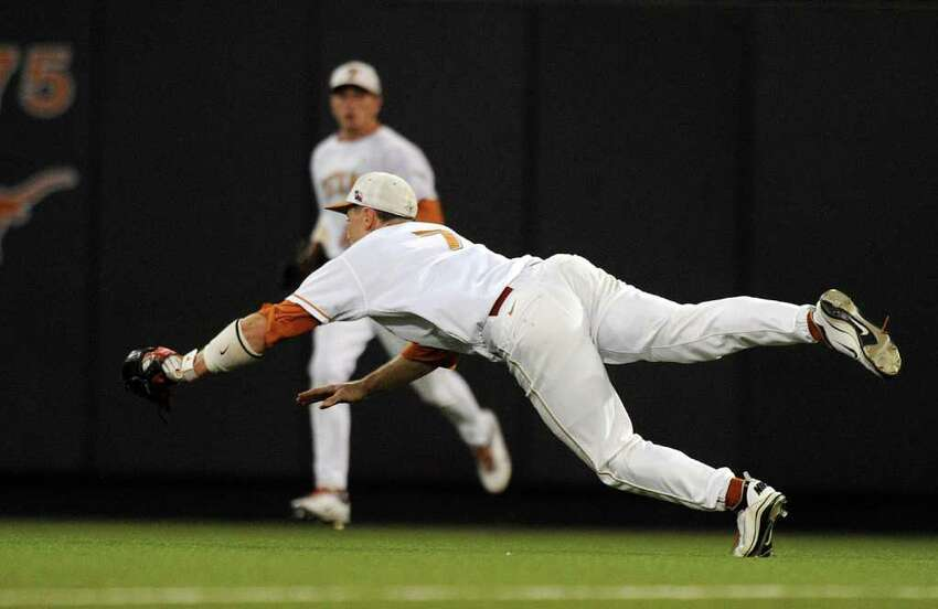 Texas second baseman Jordan Etier makes a diving catch of a bloop fly late in the game against Princeton during the NCAA Baseball Austin Regional on Friday, June 3, 2011. BILLY CALZADA / gcalzada@express-news.net