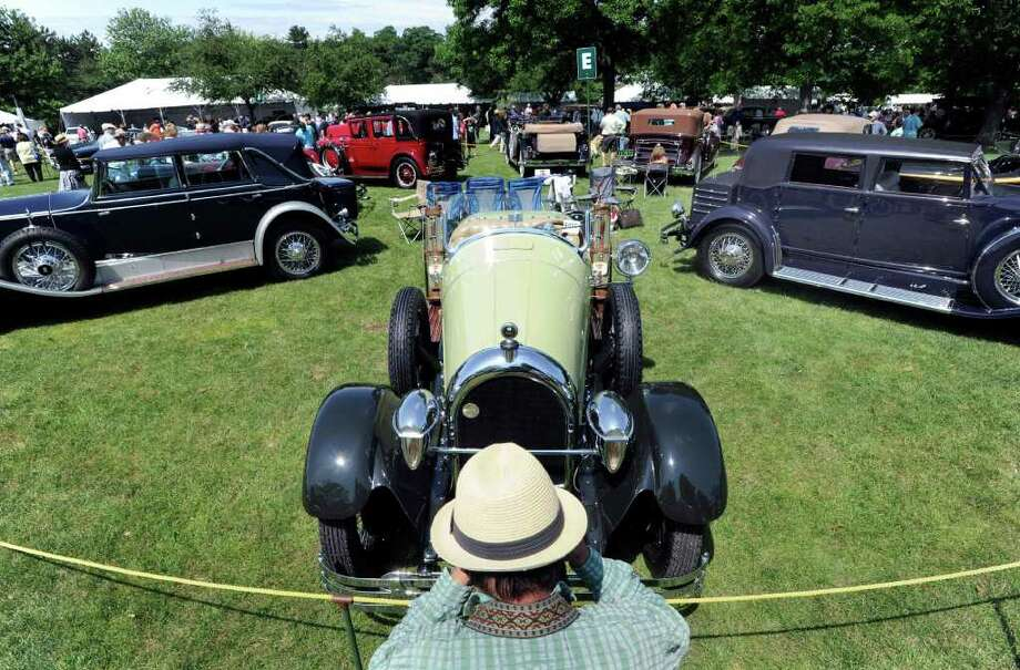 Oliver Civetta of the Bronx, N.Y., takes a photo of a 1926 Kissel Gold Bug during the Greenwich Concours d'Elegance at Roger Sherman Baldwin Park, Saturday morning, June 4, 2011. Photo: Bob Luckey / Greenwich Time