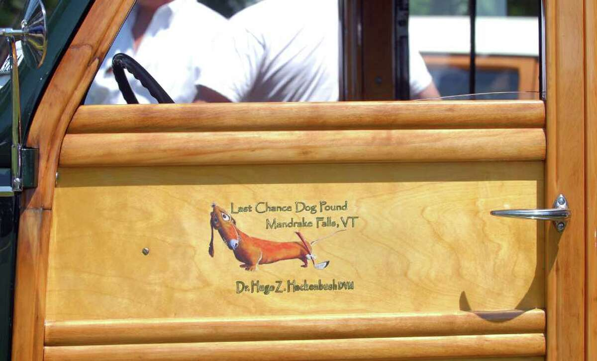 The driver's door on a 1939 Ford Deluxe Woody Wagon on display during the Greenwich Concours d'Elegance at Roger Sherman Baldwin Park, Saturday morning, June 4, 2011.