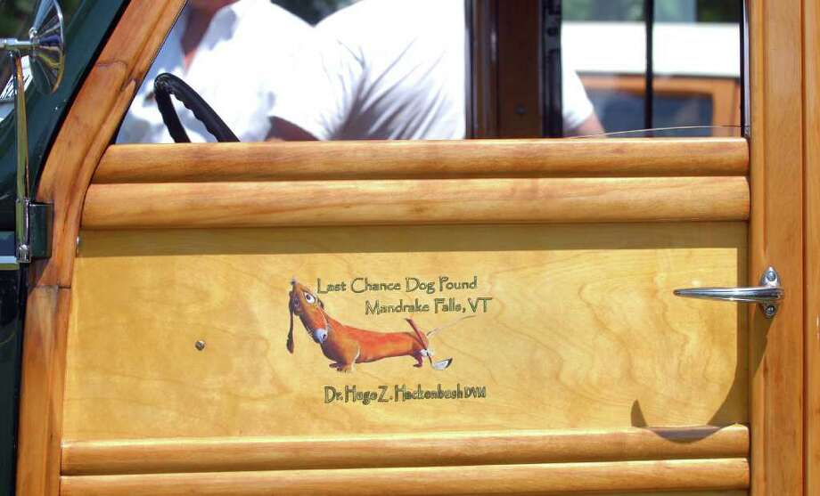 The driver's door on a 1939 Ford Deluxe Woody Wagon on display during the Greenwich Concours d'Elegance at Roger Sherman Baldwin Park, Saturday morning, June 4, 2011. Photo: Bob Luckey / Greenwich Time