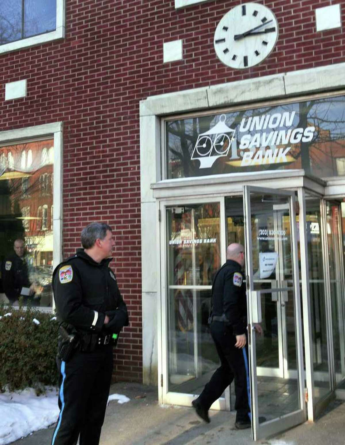 Danbury Police investigating reports of a robbery at the Union Savings Bank, on Main Street, Danbury, on Monday, Jan.11,2010.