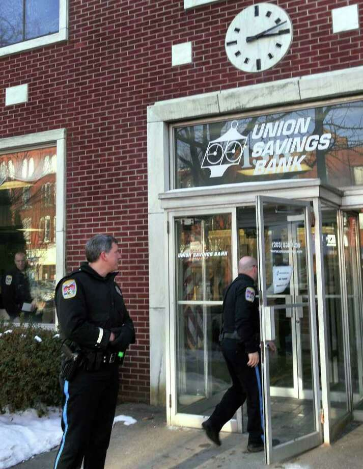 Danbury Police investigating reports of a robbery at the Union Savings Bank, on Main Street, Danbury, on Monday, Jan.11,2010. Photo: Michael Duffy / The News-Times