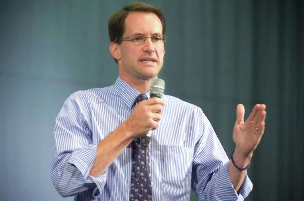 In this Sept. 2, 2009, file photo, U.S. Rep. Jim Himes, D-Conn., speaks during a health care reform town hall meeting at Norwalk High School.
