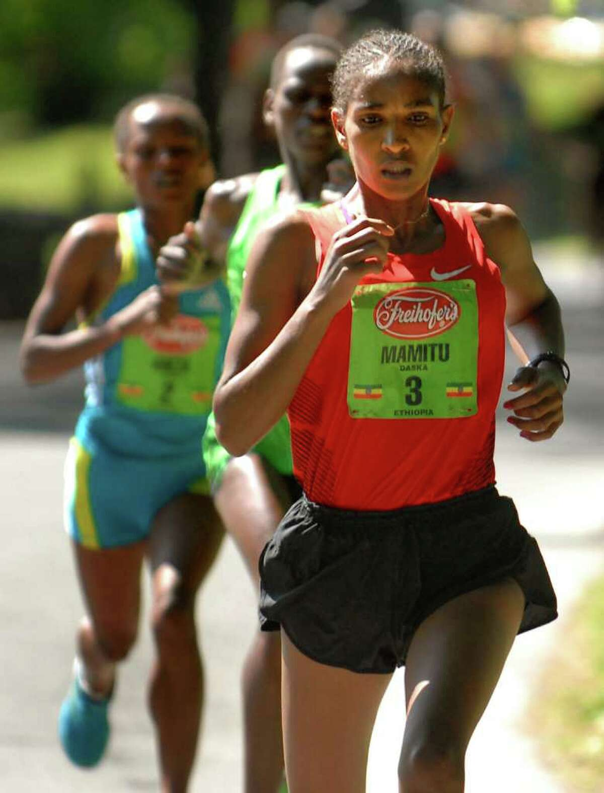 Mamitu Daska (3) of Ethiopia runs in the lead, followed by Emily Chebet and Aheza Kiros during Freihofer's 33rd Run for Women on Saturday, June 4, 2011, in Albany, N.Y. (Cindy Schultz / Times Union)