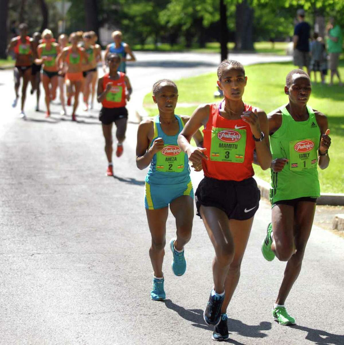 Mamitu Daska (3) of Ethiopia runs in the lead, followed by Emily Chebet (1) and Aheza Kiros (2) in Washington Park during Freihofer's 33rd Run for Women on Saturday, June 4, 2011, in Albany, N.Y. (Cindy Schultz / Times Union)
