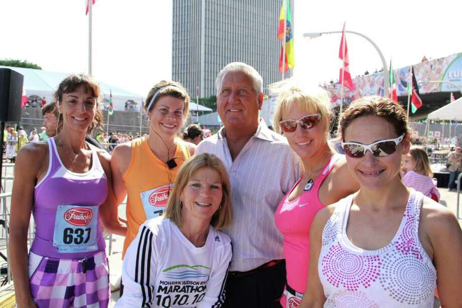 Donna Gade, of Guilderland, left, Alison Conaway, of Guilderland, Albany Mayor Jerry Jennings, Mary Hamilton, of Guilderland, Kristin Knauf, of Voorheesville, right, and Roxanne Gillen, of Guilderland, front, wait for the start of the 33rd annual Freihofer's Run for Women in Albany, Saturday, June 4, 2011. (Erin Colligan / Special To The Times Union)