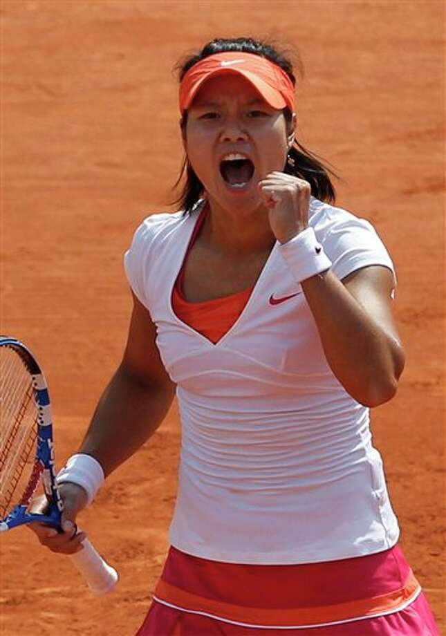 China's Li Na reacts as she plays Italy's Francesca Schiavone during their women's final match for the French Open tennis tournament at the Roland Garros stadium, Saturday June 4, 2011 in Paris.  (AP Photo/Christophe Ena) Photo: Christophe Ena, Associated Press / AP