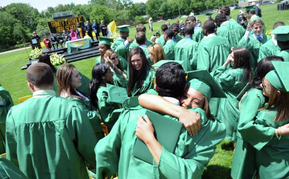 The Trinity Catholic High School Class of 2011 celebrates after receiving their diplomas as the Commencement Exercises in Stamford, Conn. on Saturday June 4, 2011. Photo: Kathleen O'Rourke / Stamford Advocate