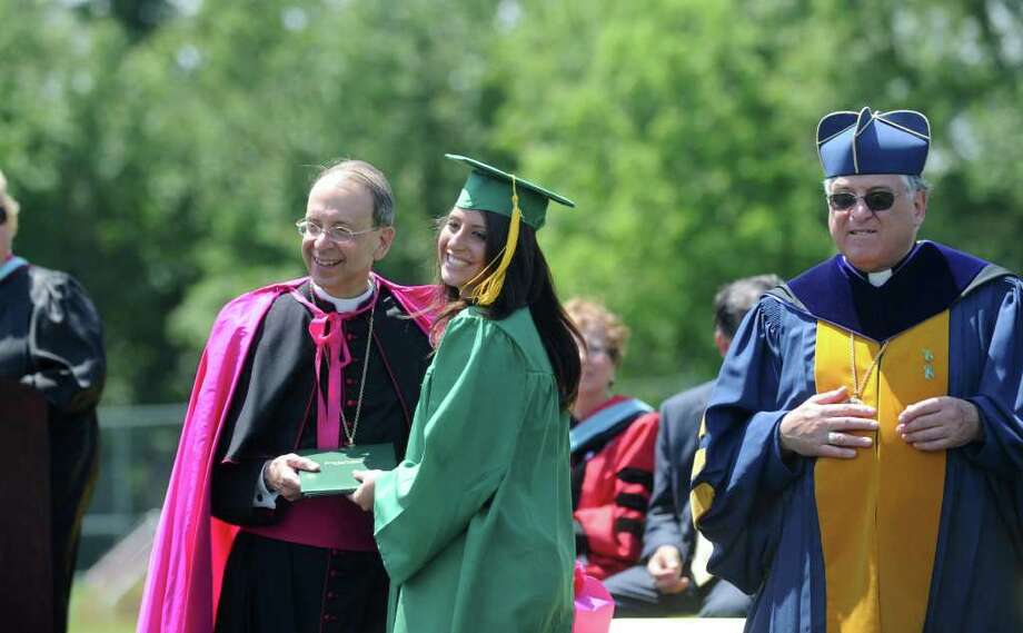 Erin Sottosanti receives her diploma from Bishop William E. Lori as the Trinity Catholic High School Class of 2011 participates in the Commencement Exercises in Stamford, Conn. on Saturday June 4, 2011. Photo: Kathleen O'Rourke / Stamford Advocate