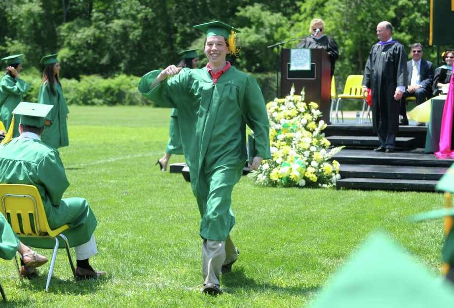 Steven Kolenberg receives his diploma as the Trinity Catholic High School Class of 2011 participates in the Commencement Exercises in Stamford, Conn. on Saturday June 4, 2011. Photo: Kathleen O'Rourke / Stamford Advocate