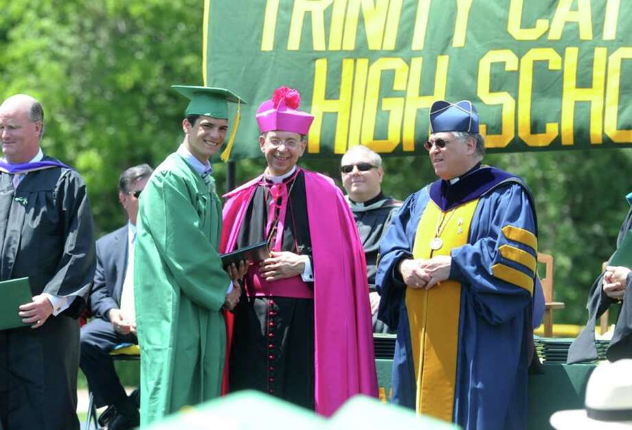 Graduates pose for photos with Bishop William E. Lori during he Trinity Catholic High School Class of 2011 Commencement Exercises in Stamford, Conn. on Saturday June 4, 2011. Photo: Kathleen O'Rourke / Stamford Advocate