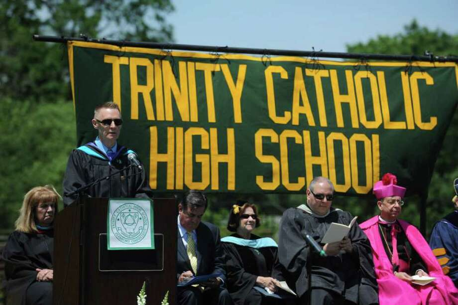John Cook, principal of Trinity Catholic High School, speaks to the Class of 2011 during the Commencement Exercises in Stamford, Conn. on Saturday June 4, 2011. Photo: Kathleen O'Rourke / Stamford Advocate
