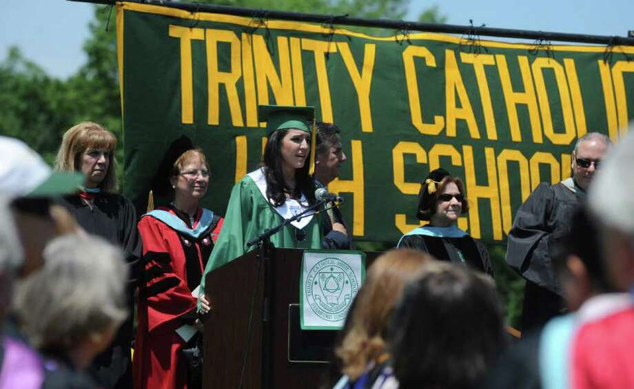 Angelica Salem sings the Star Spanled Banner during the Trinity Catholic High School Class of 2011 Commencement Exercises in Stamford, Conn. on Saturday June 4, 2011. Photo: Kathleen O'Rourke / Stamford Advocate