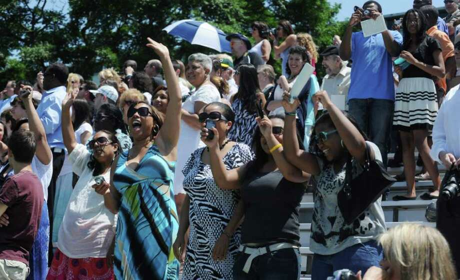Family and friends cheer on the Trinity Catholic High School Class of 2011 as they process in for the Commencement Exercises in Stamford, Conn. on Saturday June 4, 2011. Photo: Kathleen O'Rourke / Stamford Advocate
