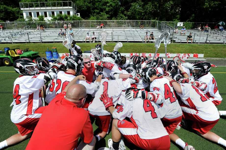 Fairfield Prep says The Lord's Prayer before the start of the Class L boys lacrosse quarterfinal between Fairfield Prep and Greenwich High School at Fairfield University, Saturday afternoon, June 4, 2011. Photo: Bob Luckey / Greenwich Time