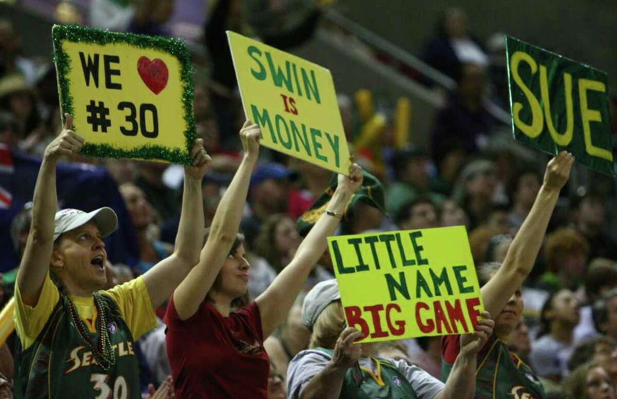 Seattle Storm fans cheer as the Storm begin the WNBA season against the Phoenix Mercury on Saturday, June 4, 2011 at KeyArena in Seattle. The storm beat the Mercury 78-71.