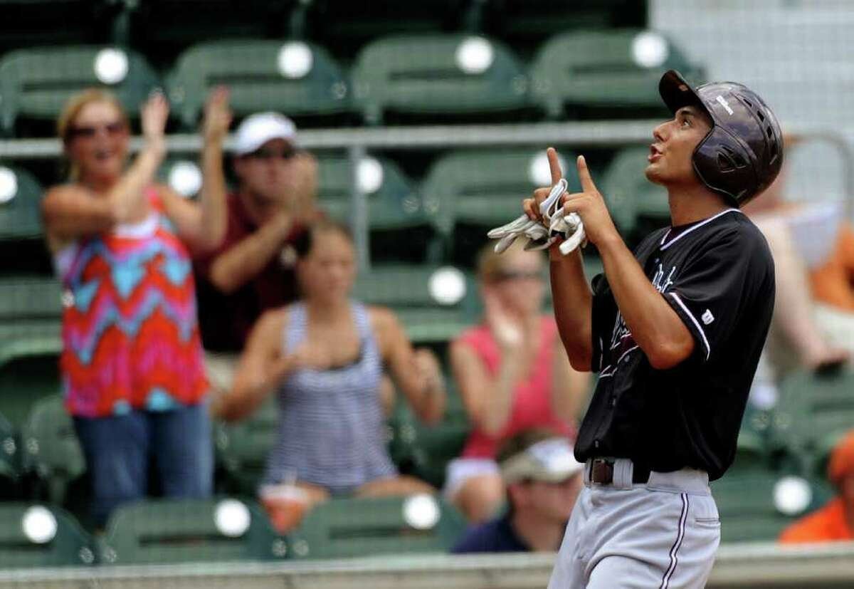 Christian Gallegos gestures skyward after scoring the second run for Texas State against Princeton at the NCAA Baseball Austin Regional on Saturday, June 4, 2011. BILLY CALZADA / gcalzada@express-news.net