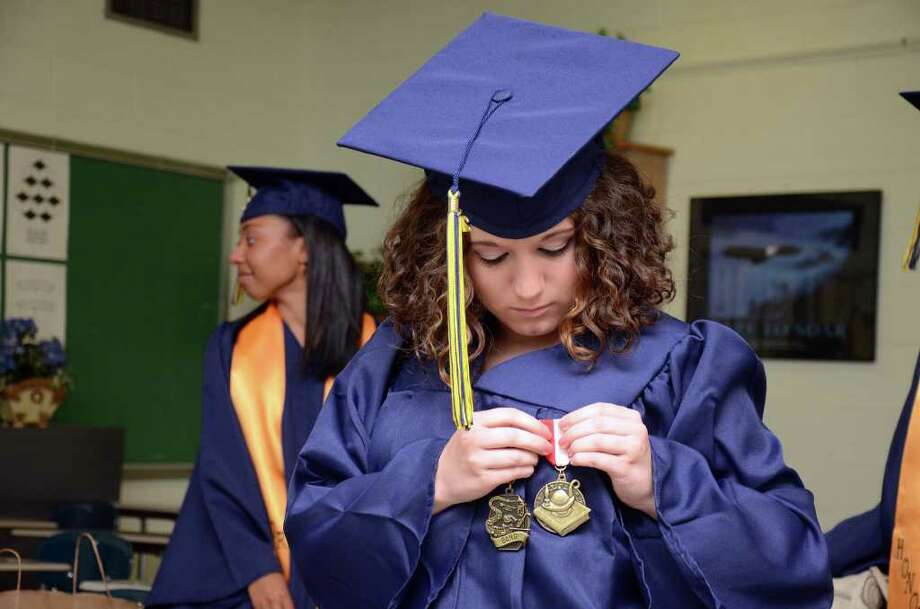 Valedictorian Jessica Harper, of Oxford, fastens her pins to her robe prior to the start of the 2011 Notre Dame Catholic High School Commencement at Notre Dame in Fairfield on Saturday, June 4, 2011. Photo: Amy Mortensen / Connecticut Post Freelance