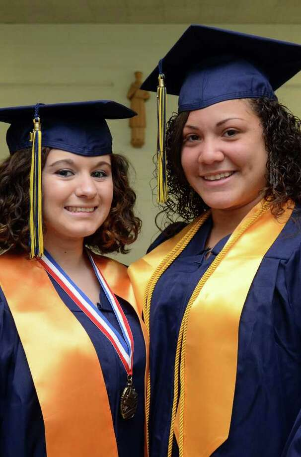 Valedictorian Jessica Harper, of Oxford and President of the Student Council Brittany Perez, pose for a photograph prior to the start of the 2011 Notre Dame Catholic High School Commencement at Notre Dame in Fairfield on Saturday, June 4, 2011. Photo: Amy Mortensen / Connecticut Post Freelance