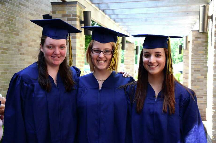 Sarah Baldwin, of Bridgeport, Courtney Morgan, of Shelton and Tracey Mauro, of Ansonia, pose for a photograph prior to the start of the 2011 Notre Dame Catholic High School Commencement at Notre Dame in Fairfield on Saturday, June 4, 2011. Photo: Amy Mortensen / Connecticut Post Freelance