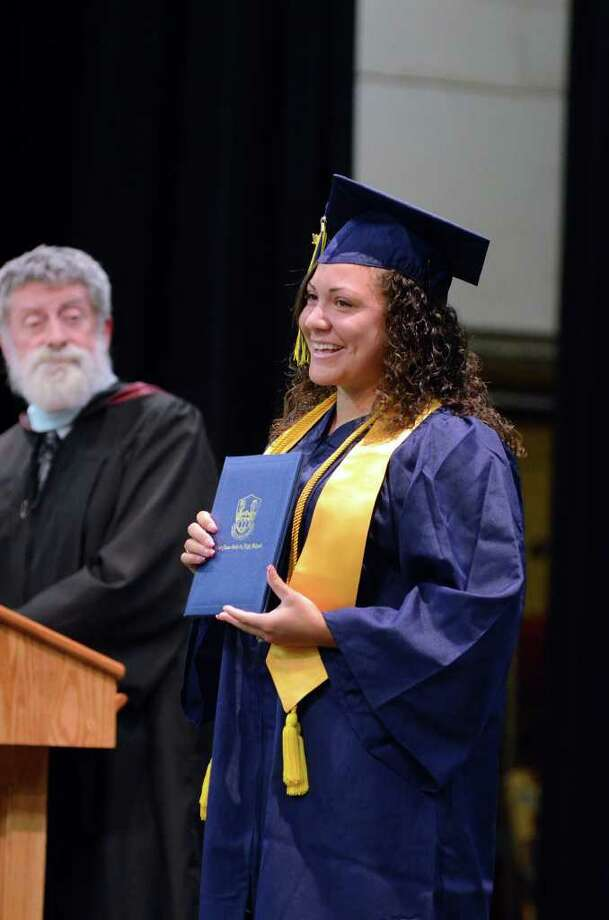 Student Council President Brittany Perez smiles after receiving her diploma during the 2011 Notre Dame Catholic High School Commencement at Notre Dame in Fairfield on Saturday, June 4, 2011. Photo: Amy Mortensen / Connecticut Post Freelance