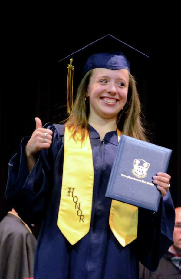 Rebecca Petronchak gives the thumbs up signal after receiving her diploma during the 2011 Notre Dame Catholic High School Commencement at Notre Dame in Fairfield on Saturday, June 4, 2011. Photo: Amy Mortensen / Connecticut Post Freelance