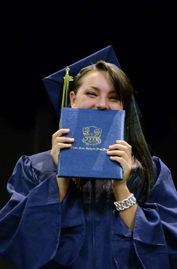 Abigail Baricko hides behind her diploma as she laughs at the mispronunciation of her name during the 2011 Notre Dame Catholic High School Commencement at Notre Dame in Fairfield on Saturday, June 4, 2011. Photo: Amy Mortensen / Connecticut Post Freelance