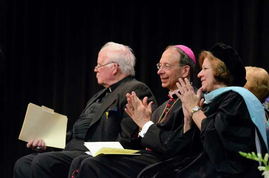 Reverend Bill Sangiovanni, President of Notre Dame High School; Bishop William Lori and Dr. Margaret Dames, Superintendent of Schools Diocese of Bridgeport, applaud during the 2011 Notre Dame Catholic High School Commencement at Notre Dame in Fairfield on Saturday, June 4, 2011. Photo: Amy Mortensen / Connecticut Post Freelance