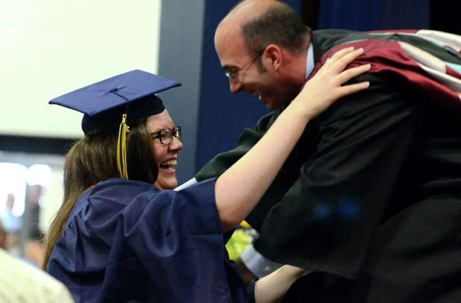 Caitlin Shea-Vantine hugs Principal Christopher Cipriano after being awarded the Outstanding Senior Award during the 2011 Notre Dame Catholic High School Commencement at Notre Dame in Fairfield on Saturday, June 4, 2011. Photo: Amy Mortensen / Connecticut Post Freelance