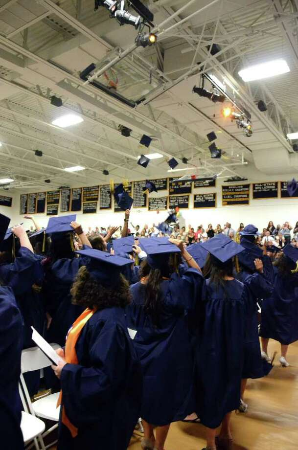 Only a handful of graduates tossed their caps in the air during the 2011 Notre Dame Catholic High School Commencement at Notre Dame in Fairfield on Saturday, June 4, 2011. Photo: Amy Mortensen / Connecticut Post Freelance