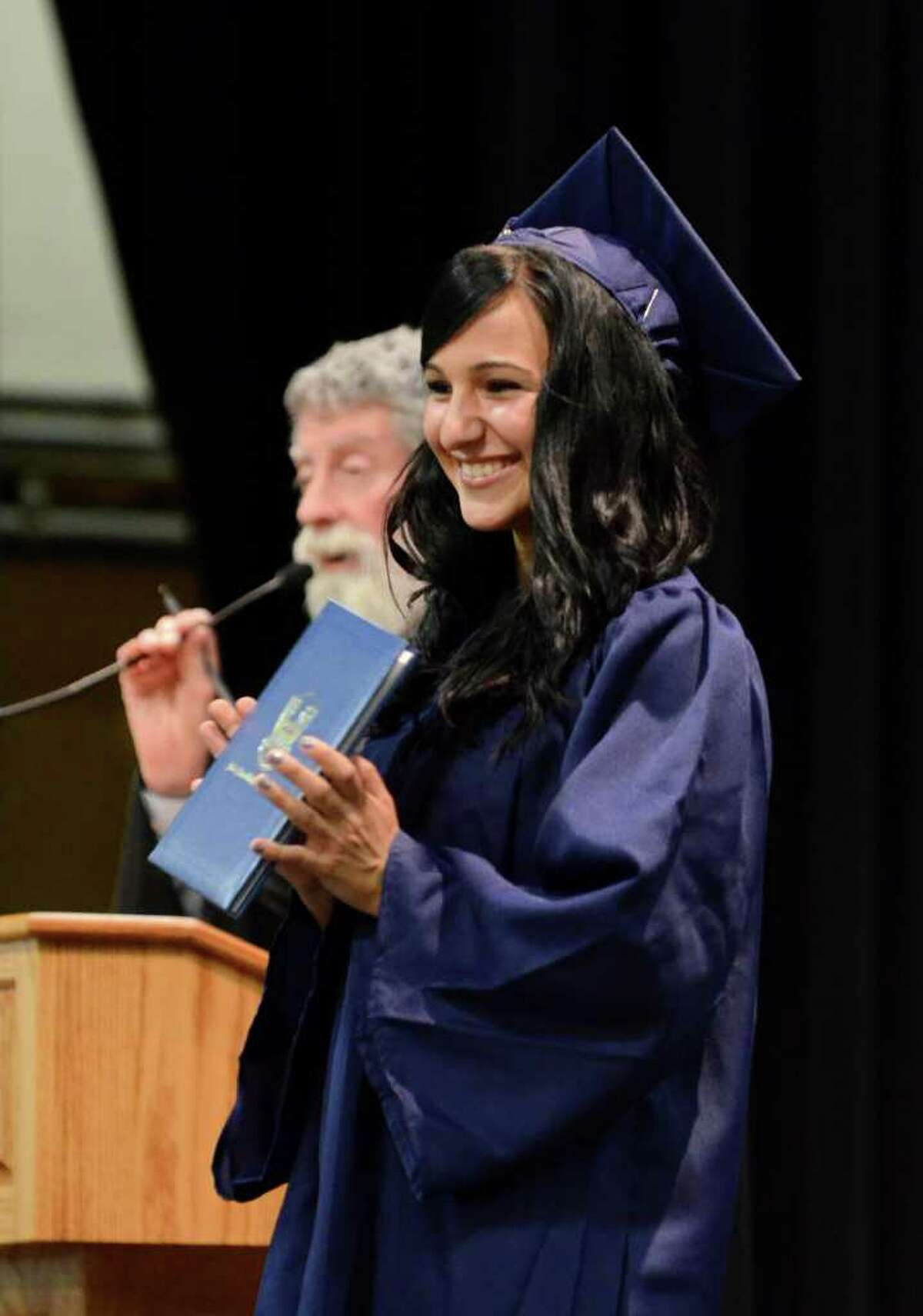 Paige Vichiola proudly displays her diploma during the 2011 Notre Dame Catholic High School Commencement at Notre Dame in Fairfield on Saturday, June 4, 2011.