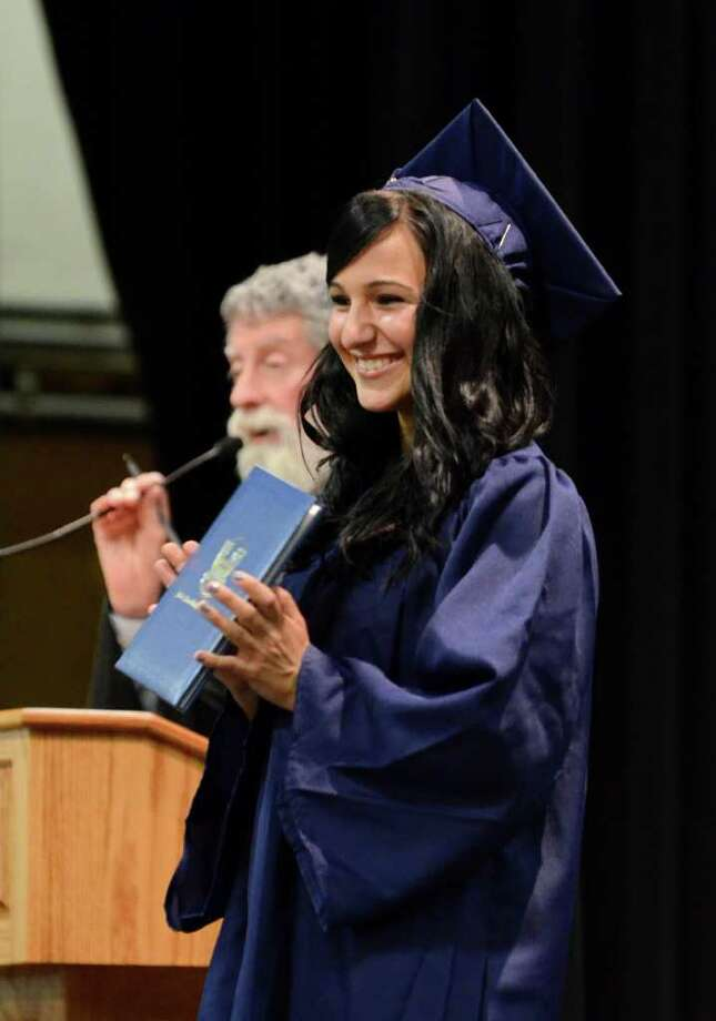 Paige Vichiola proudly displays her diploma during the 2011 Notre Dame Catholic High School Commencement at Notre Dame in Fairfield on Saturday, June 4, 2011. Photo: Amy Mortensen / Connecticut Post Freelance