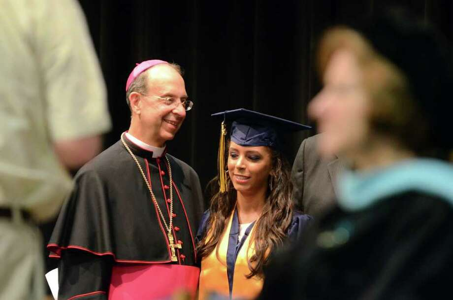 Dianne Gutierrez poses for a photo with Bishop William Lori during the 2011 Notre Dame Catholic High School Commencement at Notre Dame in Fairfield on Saturday, June 4, 2011. Photo: Amy Mortensen / Connecticut Post Freelance