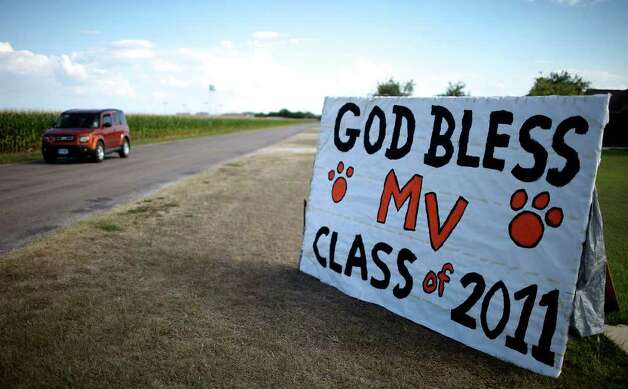 "A motorist passes a sign near Medina Valley High School in Rhonda Dungan's front yard Saturday June 4, 2011 in Castroville, Tx. Dungan said ""It's just the small town community coming together.""  (PHOTO BY EDWARD A. ORNELAS/eaornelas@express-news.net) Photo: EDWARD A. ORNELAS, Edward A. Ornelas/Express-News / © SAN ANTONIO EXPRESS-NEWS (NFS)"