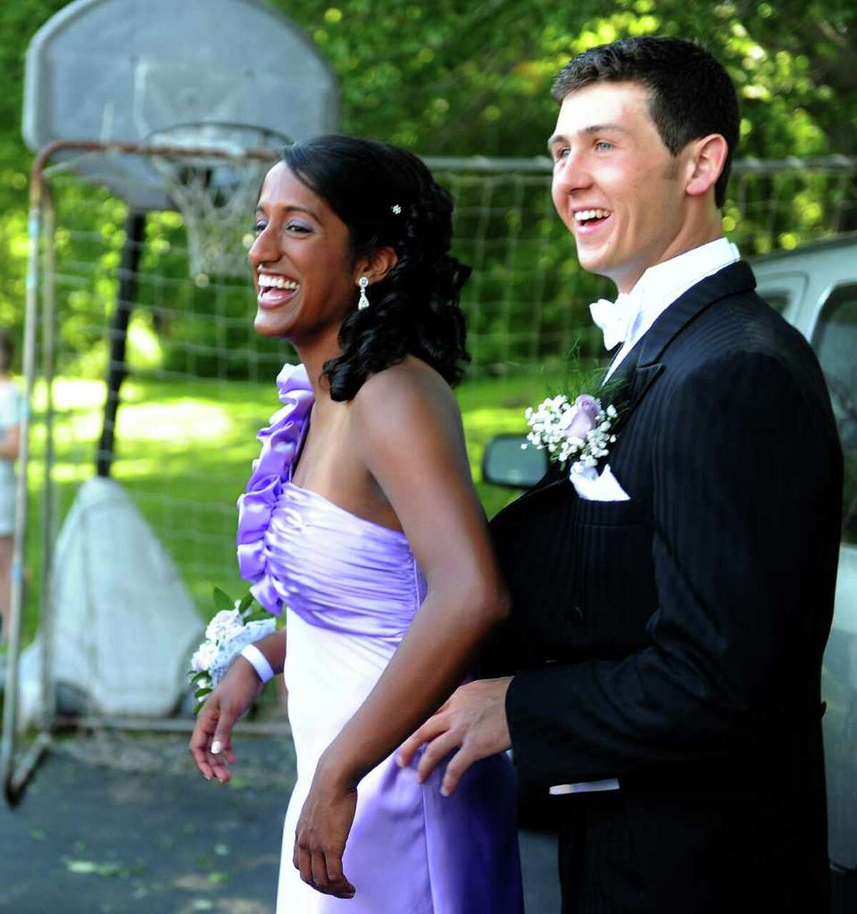 James Tate and Sonali Rodrigues pose for photos before going to their senior prom on Saturday, June 4, 2011.
