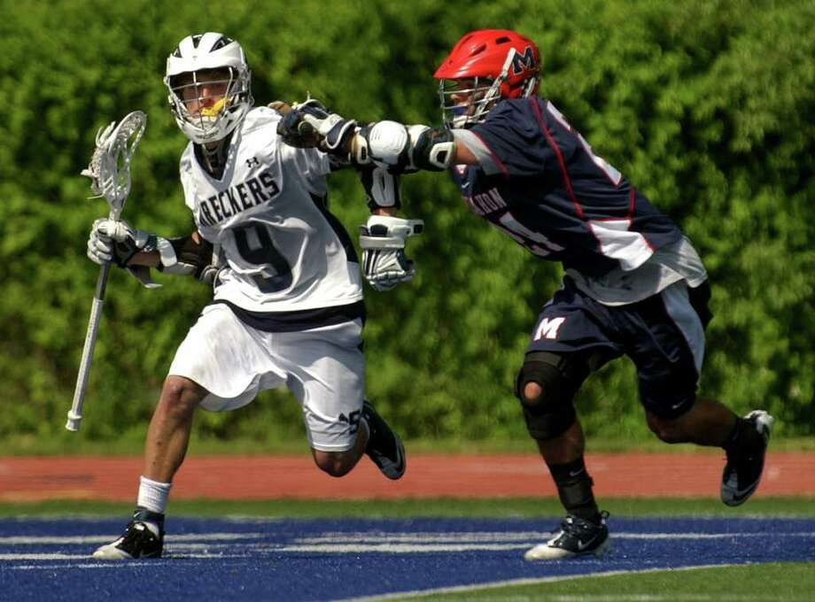 Highlights from the Class L boys lacrosse playoffs between Staples and Brien McMahon at Staples High School in Westport, Conn. on Saturday June 4, 2011.  Staples' #9 Charlie Ross, left, gets shoved by McMahon's #24 Ryan Scott. Photo: Christian Abraham / Connecticut Post