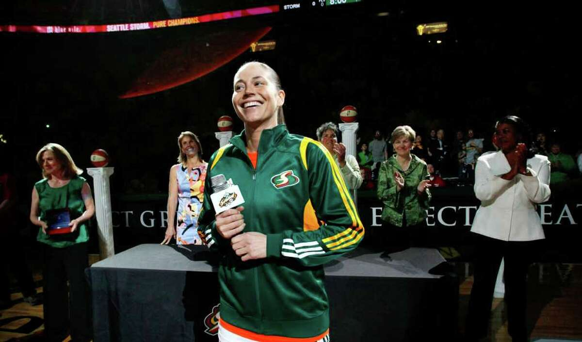 Seattle Storm's Sue Bird speaks during a pre-game ceremony celebrating the team's 2010 championship before their WNBA basketball game against the Phoenix Mercury.