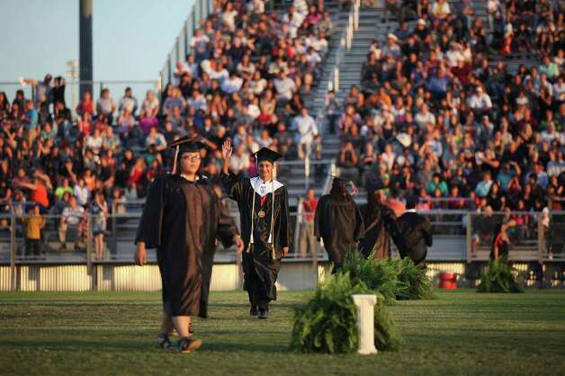 Medina Valley High School graduates make their way onto the field during graduation held Saturday June 4, 2011 at Panther Stadium in Castroville, Tx. (PHOTO BY EDWARD A. ORNELAS/eaornelas@express-news.net) Photo: EDWARD A. ORNELAS, Edward A. Ornelas/Express-News / © SAN ANTONIO EXPRESS-NEWS (NFS)