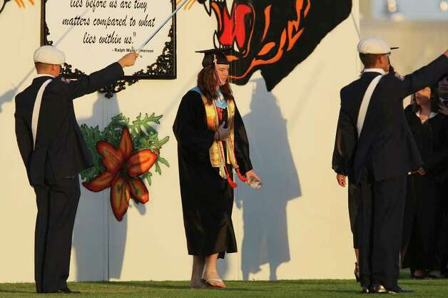 Medina Valley High School valedictorian Angela Hildenbrand walks onto the field during graduation held Saturday June 4, 2011 at Panther Stadium in Castroville, Tx. (PHOTO BY EDWARD A. ORNELAS/eaornelas@express-news.net) Photo: EDWARD A. ORNELAS, Edward A. Ornelas/Express-News / © SAN ANTONIO EXPRESS-NEWS (NFS)
