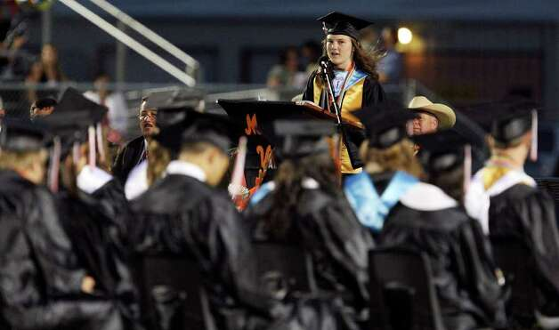 Medina Valley High School valedictorian Angela Hildenbrand (center) speaks during the Medina Valley High School graduation held Saturday June 4, 2011 at Panther Stadium in Castroville, Tx. (PHOTO BY EDWARD A. ORNELAS/eaornelas@express-news.net) Photo: EDWARD A. ORNELAS, Edward A. Ornelas/Express-News / © SAN ANTONIO EXPRESS-NEWS (NFS)