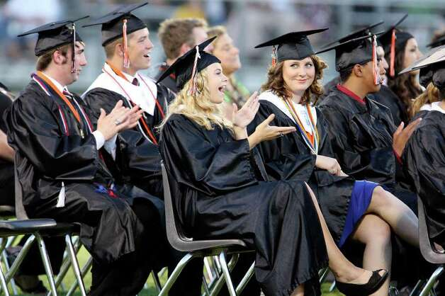 Medina Valley High School graduates yell for a speaker  during the Medina Valley High School graduation held Saturday June 4, 2011 at Panther Stadium in Castroville, Tx. (PHOTO BY EDWARD A. ORNELAS/eaornelas@express-news.net) Photo: EDWARD A. ORNELAS, Edward A. Ornelas/Express-News / © SAN ANTONIO EXPRESS-NEWS (NFS)