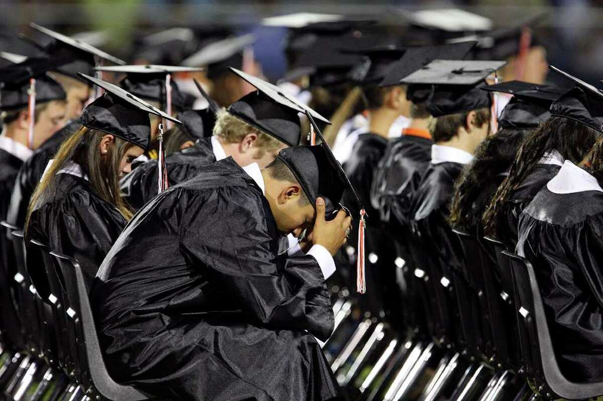 Medina Valley High School graduates take part in a prayer lead by valedictorian Angela Hildenbrand (not pictured) during the Medina Valley High School graduation held Saturday June 4, 2011 at Panther Stadium in Castroville, Tx. (PHOTO BY EDWARD A. ORNELAS/eaornelas@express-news.net)