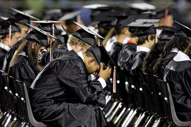 Medina Valley High School graduates take part in a prayer lead by valedictorian Angela Hildenbrand (not pictured) during the Medina Valley High School graduation held Saturday June 4, 2011 at Panther Stadium in Castroville, Tx. (PHOTO BY EDWARD A. ORNELAS/eaornelas@express-news.net) Photo: EDWARD A. ORNELAS, Edward A. Ornelas/Express-News / © SAN ANTONIO EXPRESS-NEWS (NFS)