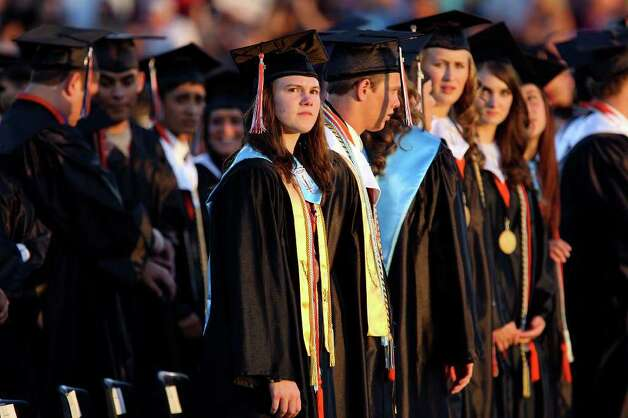 Medina Valley High School valedictorian Angela Hildenbrand (center) looks into the crowd during the Medina Valley High School graduation held Saturday June 4, 2011 at Panther Stadium in Castroville, Tx. (PHOTO BY EDWARD A. ORNELAS/eaornelas@express-news.net) Photo: EDWARD A. ORNELAS, Edward A. Ornelas/Express-News / © SAN ANTONIO EXPRESS-NEWS (NFS)