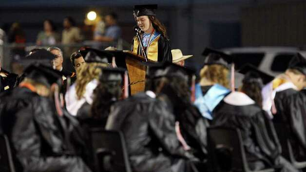 Medina Valley High School valedictorian Angela Hildenbrand (center) leads a prayer during the Medina Valley High School graduation held Saturday June 4, 2011 at Panther Stadium in Castroville, Tx. (PHOTO BY EDWARD A. ORNELAS/eaornelas@express-news.net) Photo: EDWARD A. ORNELAS, Edward A. Ornelas/Express-News / © SAN ANTONIO EXPRESS-NEWS (NFS)