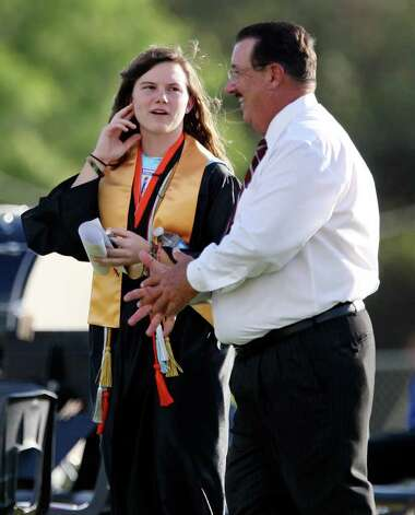 Medina Valley High School valedictorian Angela Hildenbrand (left) talks with Medina Valley ISD superintendent James Stansberry before the Medina Valley High School graduation held Saturday June 4, 2011 at Panther Stadium in Castroville, Tx. (PHOTO BY EDWARD A. ORNELAS/eaornelas@express-news.net) Photo: EDWARD A. ORNELAS, Edward A. Ornelas/Express-News / © SAN ANTONIO EXPRESS-NEWS (NFS)