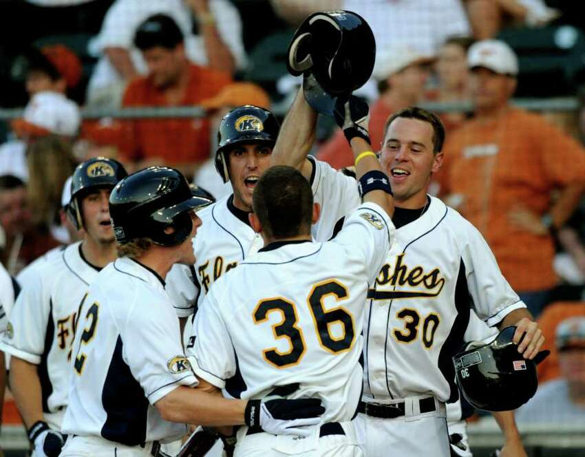 Kent State's David Lyon (36) is congratulated by teammates after hitting a grand slam home run against Texas during NCAA Baseball Austin Regional action on Saturday, June 4, 2011. BILLY CALZADA / gcalzada@express-news.net